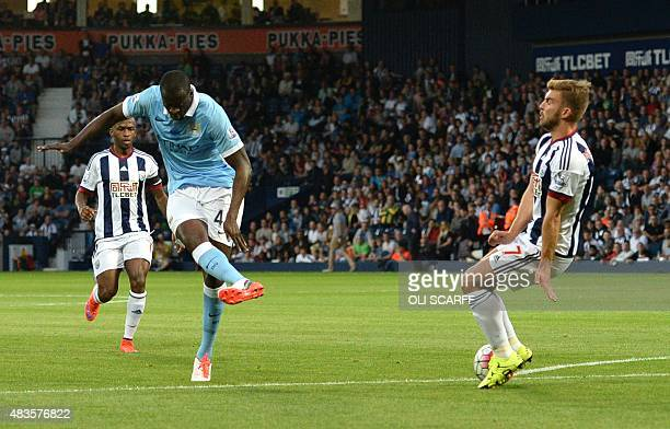 Manchester City's Ivorian midfielder Yaya Toure scores from a deflection during the English Premier League football match between West Bromwich...