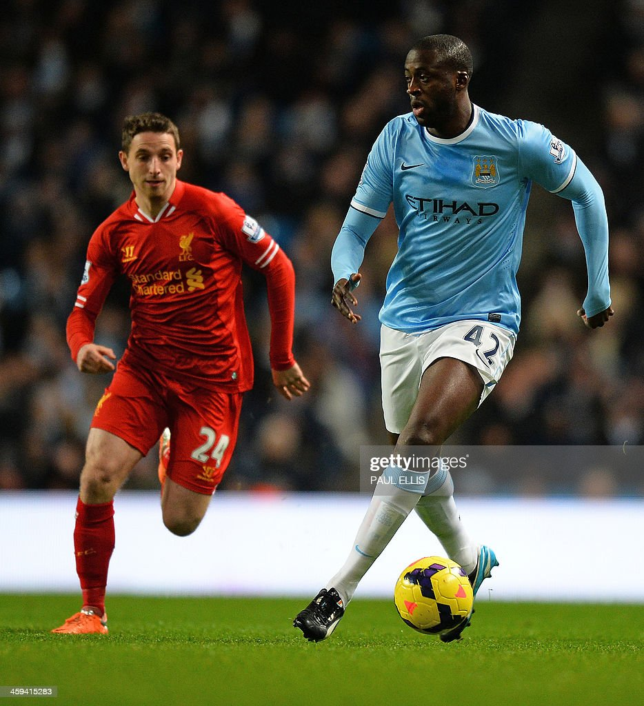 Manchester City's Ivorian midfielder Yaya Toure (R) vies with Liverpool's Welsh midfielder Joe Allen (L) during the English Premier League football match between Manchester City and Liverpool at Etihad Stadium in Manchester, northwest England on December 26, 2013. AFP PHOTO / PAUL ELLIS USE. No use with unauthorized audio, video, data, fixture lists, club/league logos or live services. Online in-match use limited to 45 images, no video emulation. No use in betting, games or single club/league/player publications.