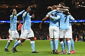 Manchester City's Ivorian striker Wilfried Bony and Manchester City's Spanish midfielder David Silva join the celebration after Manchester City's...