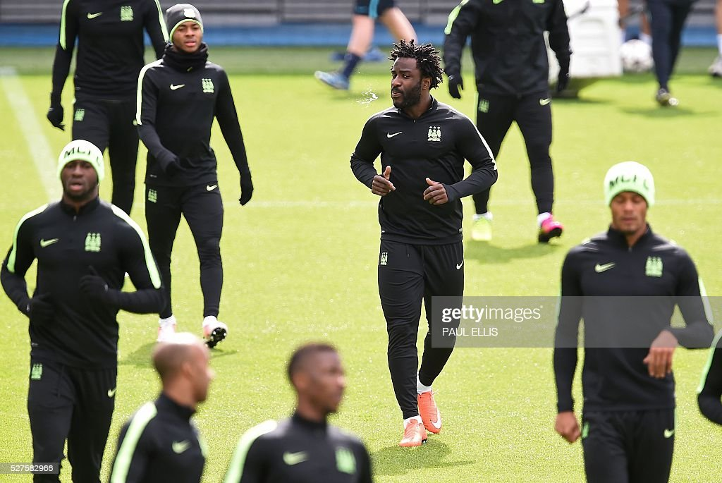 Manchester City's Ivorian striker Wilfried Bony (C) attends a team training session at the City Academy in Manchester, north west England, on May 3, 2016. Manchester City will play against Real Madrid CF in a UEFA Champions League semi-final second leg football match in Madrid on May 4. / AFP / PAUL