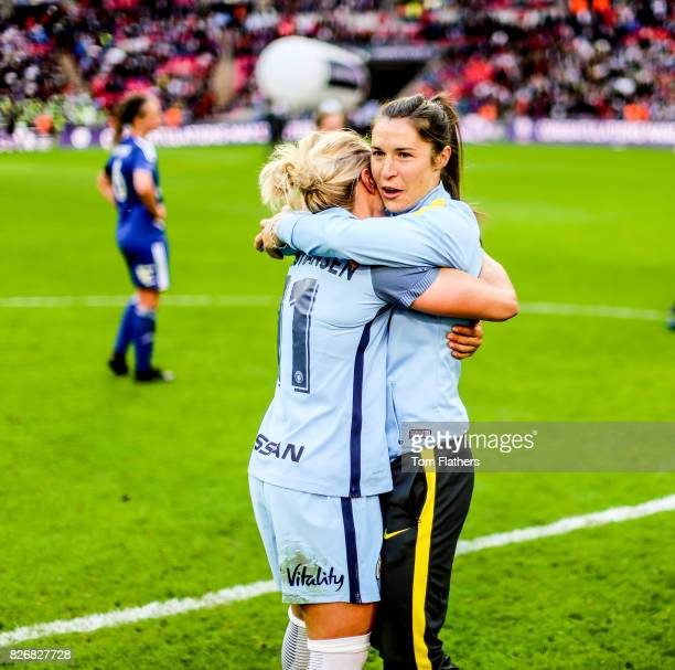 Manchester City's Izzy Christiansen and Jane Ross celebrate winning the FA Cup