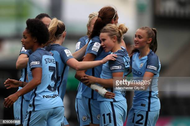 Manchester City's Izzy Christiansen celebrates scoring her sides fifth goal of the game with teammates