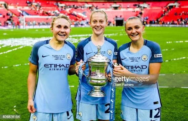 Manchester City's Izzy Christiansen Keira Walsh and Georgia Stanway celebrate winning the FA Cup