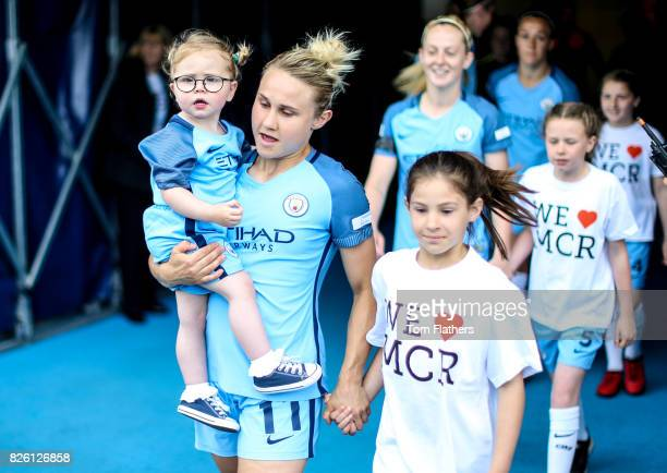 Manchester City's Izzy Christiansen walks out to play Arsenal