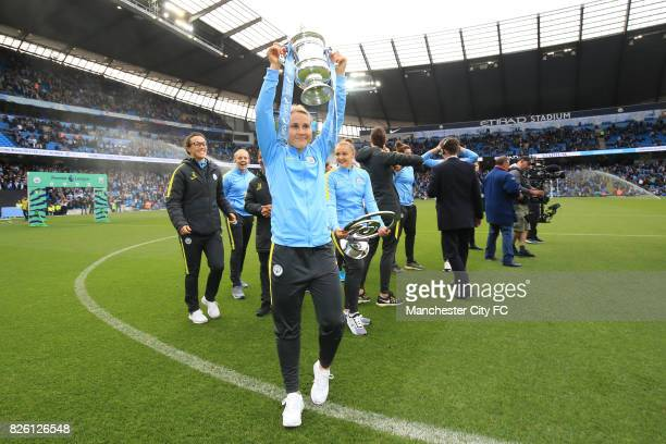 Manchester City's Izzy Christiansen with the SSE Women's FA Cup Trophy