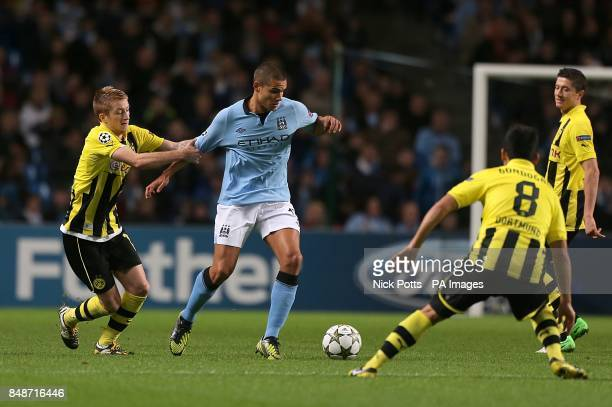 Manchester City's Jack Rodwell and Borussia Dortmund's Marco Reus battle for the ball