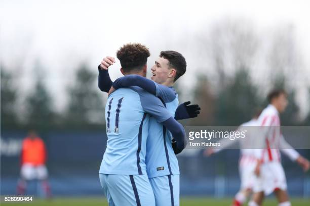 Manchester City's Jadon Sancho and Phil Foden in action against Stoke City