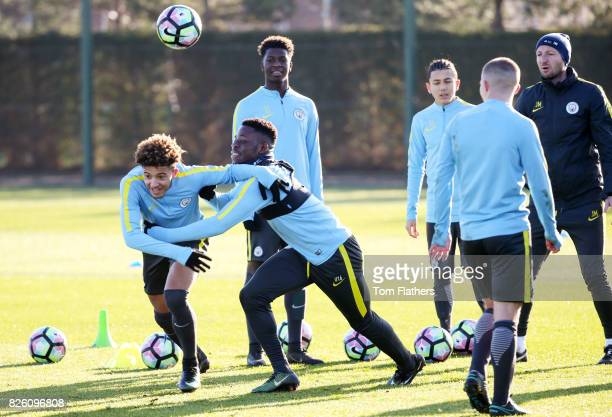 Manchester City's Jadon Sancho and Tom DeleBashiru during training at City Football Academy