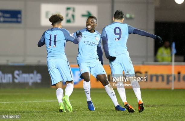 Manchester City's Jadon Sancho celebrates with Thierry Ambrose and Brahim Diaz after scoring against Everton