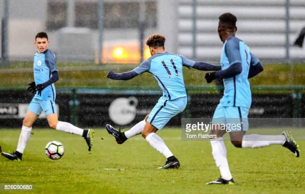 Manchester City's Jadon Sancho scores against Stoke City