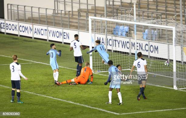 Manchester City's Jadon Sancho scores his side's first goal of the game against Tottenham Hotspur