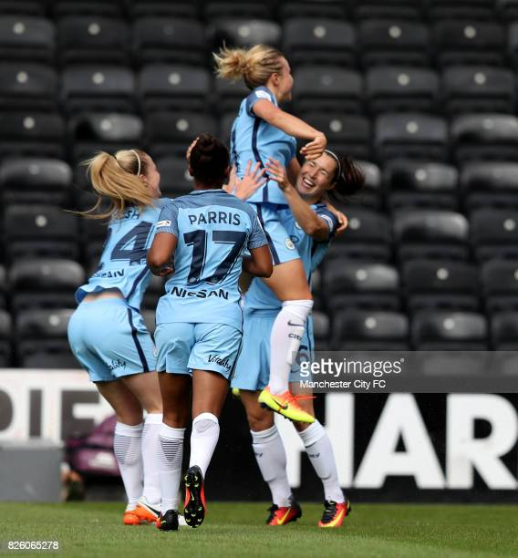 Manchester City's Jane Ross celebrates scoring her sides first goal of the game with teammates