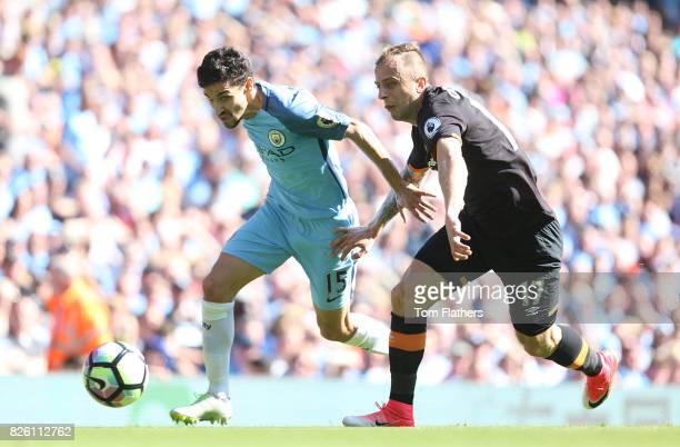 Manchester City's Jesus Navas and Hull City's Kamil Grosicki battle for the ball