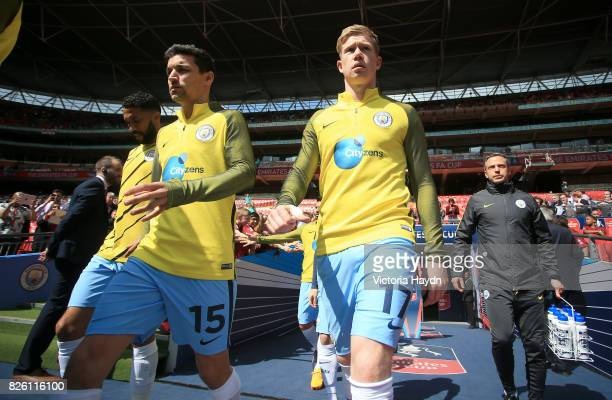 Manchester City's Jesus Navas and Kevin De Bruyne enter the pitch