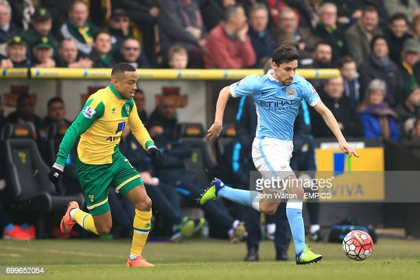 Manchester City's Jesus Navas and Norwich City's Martin Olsson battle for the ball