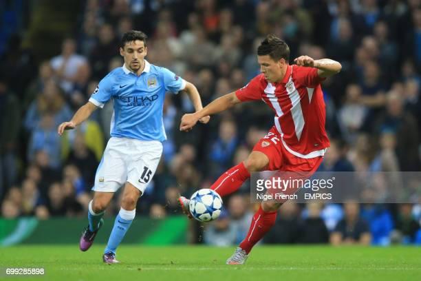 Manchester City's Jesus Navas and Sevilla's Yevhen Konoplyanka battle for the ball