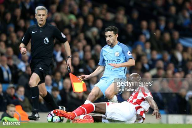 Manchester City's Jesus Navas and Stoke City's Bruno Martins Indi battle for the ball