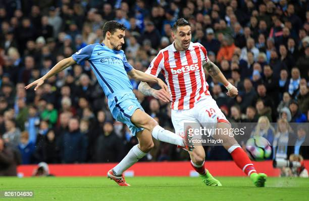Manchester City's Jesus Navas and Stoke City's Geoff Cameron battle for the ball