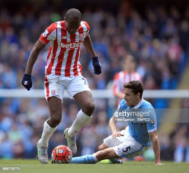Manchester City's Jesus Navas and Stoke City's Giannelli Imbula battle for the ball