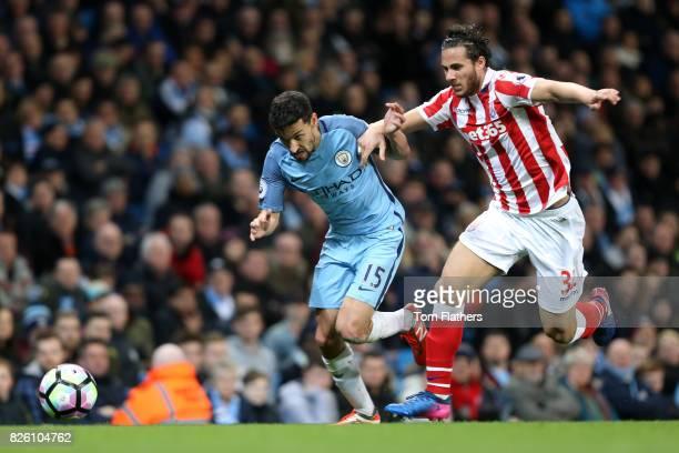 Manchester City's Jesus Navas and Stoke City's Ramadan Sobhi battle for the ball