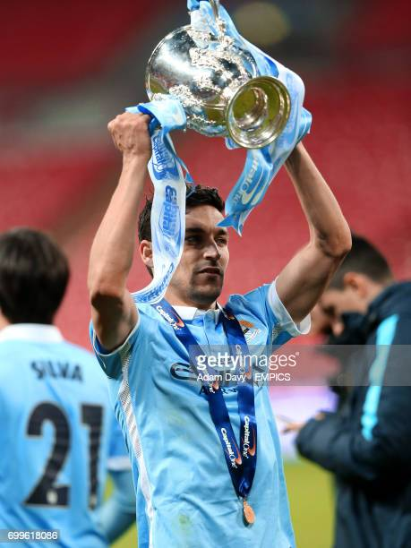 Manchester City's Jesus Navas celebrates with the Capital One Cup trophy
