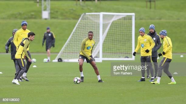 Manchester City's Jesus Navas Denzeil Boadu and Aleix Garcia in training