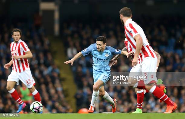 Manchester City's Jesus Navas gets away from Stoke City's Geoff Cameron