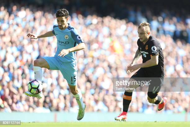 Manchester City's Jesus Navas in action with Hull City's Kamil Grosicki