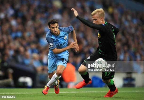 Manchester City's Jesus Navas takes on Borussia Monchengladbach's Oscar Wendt