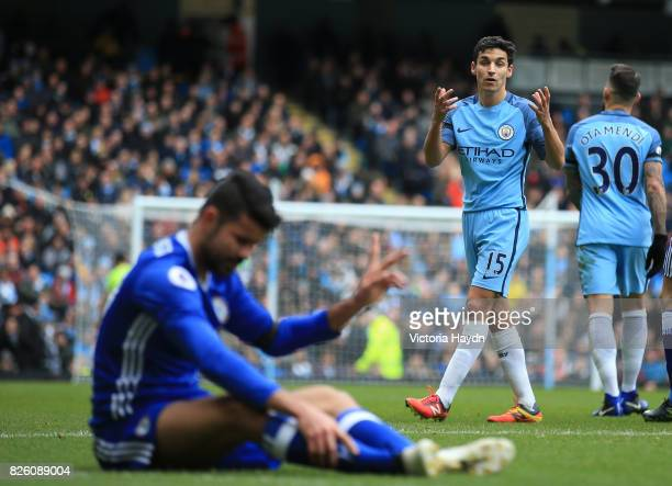 Manchester City's Jesus Navas talks to Chelsea's Diego Costa during the match