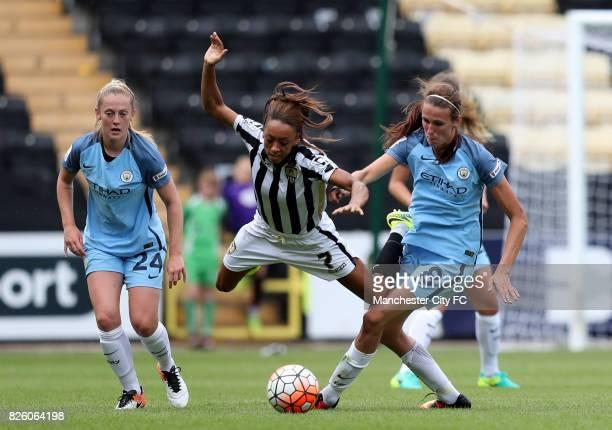 Manchester City's Jill Scott and Notts County's Jess Clarke battle for the ball