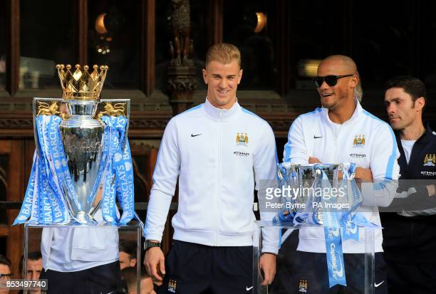 Manchester City's Joe Hart and Vincent Kompany with the Premier League and Capital One Cup Trophies during the Barclays Premier League Victory Parade...