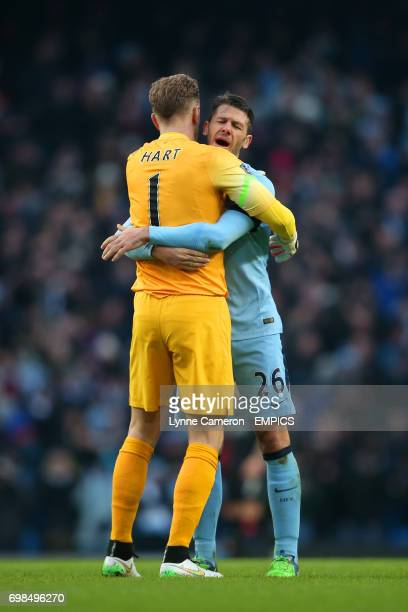 Manchester City's Joe Hart hugs Manchester City's Martin Demichelis after the final whistle