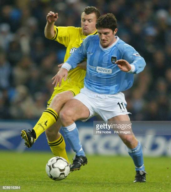 Manchester City's John Macken challenges Graham Stewart of Charlton Athletic during their Barclaycard Premiership match at City of Manchester Stadium...
