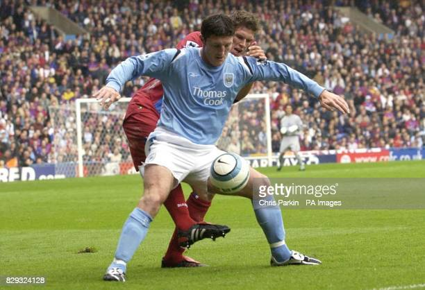 Manchester City's John Macken shields the ball from Crystal Palace's Mark Hudson during the Barclays Premiership match at Selhurst Park London...