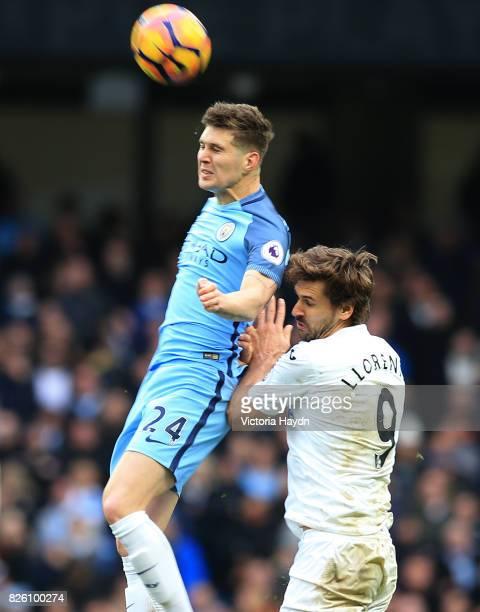 Manchester City's John Stones and Swansea City's Fernando Llorente battle for the ball