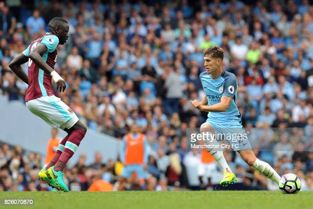 Manchester City's John Stones and West Ham United's Cheikhou Kouyate in action during the Barclay's Premiership match at the Etihad Stadium...