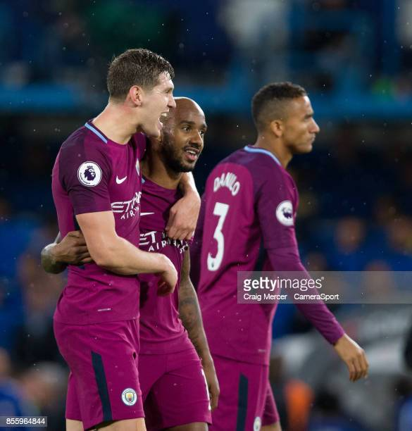 Manchester City's John Stones celebrates his side's victory at the final whistle with team mate Fabian Delph during the Premier League match between...