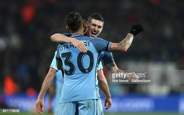 Manchester City's John Stones celebrates scoring his sides fifth goal with Nicolas Otamendi during the Emirates FA Cup Third Round match between West...