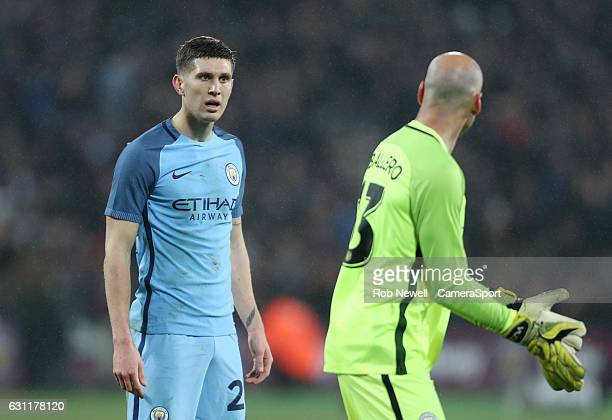 Manchester City's John Stones in discussion with team mate Wilfredo Caballero during the Emirates FA Cup Third Round match between West Ham United...