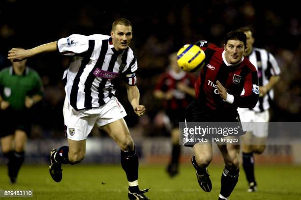 Manchester City's Jon Macken and West Bromwich Albion's Darren Purse battle for the ball