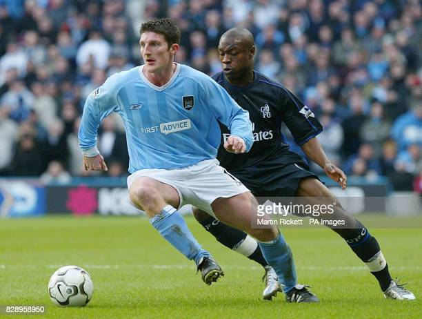 Manchester City's Jon Macken battles with Chelsea's William Gallas during the Barclaycard Premiership match at the city of Manchester Stadium...