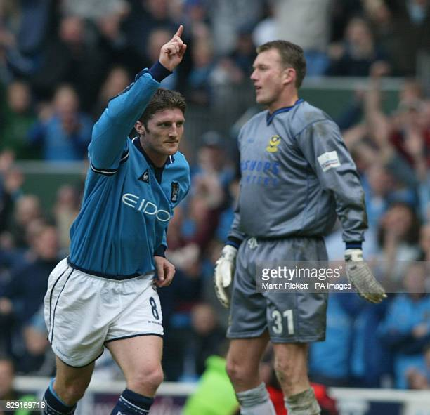 Manchester City's Jon Macken celebrates his goal against Portsmouth past keeper Dave Beasant during the Nationwide Division 1 game at Maine Road...