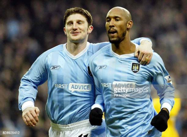Manchester City's Jon Macken celebrates with team mate Nicolas Anelka after Anelka scored against Blackburn during 11 draw in the FA Barclaycard...