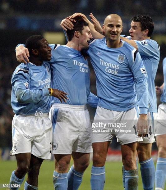 Manchester City's Jon Macken celebrates with teammates after scoring against Aston Villa during the Barclays Premiership match at The City of...