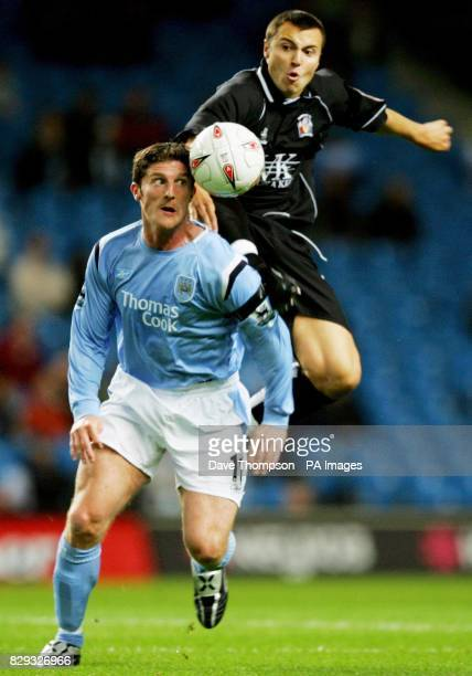 Manchester City's Jon Macken in action against Barnsley's Antony Kay during their Carling Cup second round match at the City of Manchester Stadium...