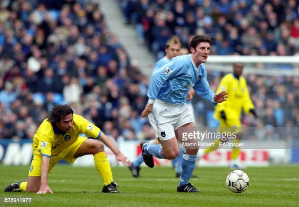 Manchester City's Jon Macken skips away from a challenge by Birmingham City's Jeff Kenna during the Barclaycard Premiership match at the City of...