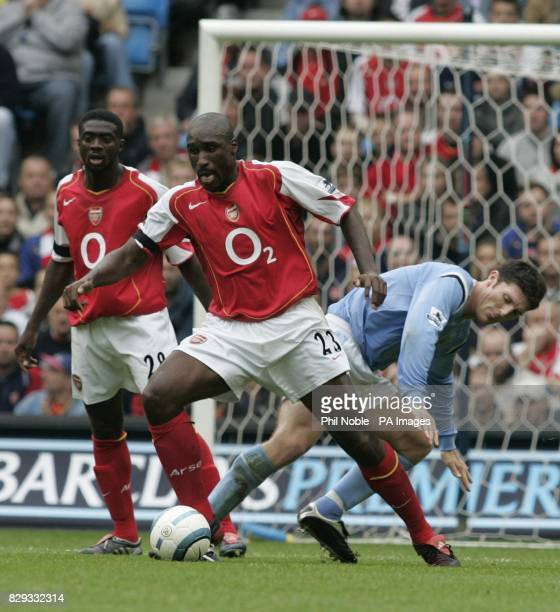 Manchester City's Jonathan Macken challenges Sol Campbell of Arsenal for the ball during the Barclaycard Premiership match at The City of Manchester...
