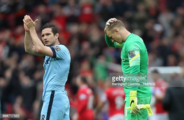 Manchester City's keeper Joe Hart and Frank Lampard look dejected at the end of the game against Manchester United
