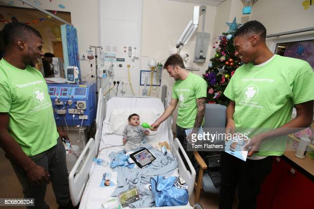 Manchester City's Kelechi Iheanacho Aleix Garcia and Tosin Adarabioyowith a patient while visiting The Royal Manchester Childrenv¢¬Ä¬ôs Hospital